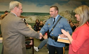 Sergeant McNair is congratulated by Mayor Pagliughi